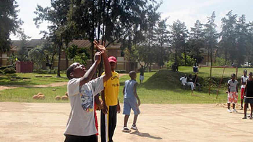 Teenagers playing basketball at last year's camp. The New Times / D. Umutesi