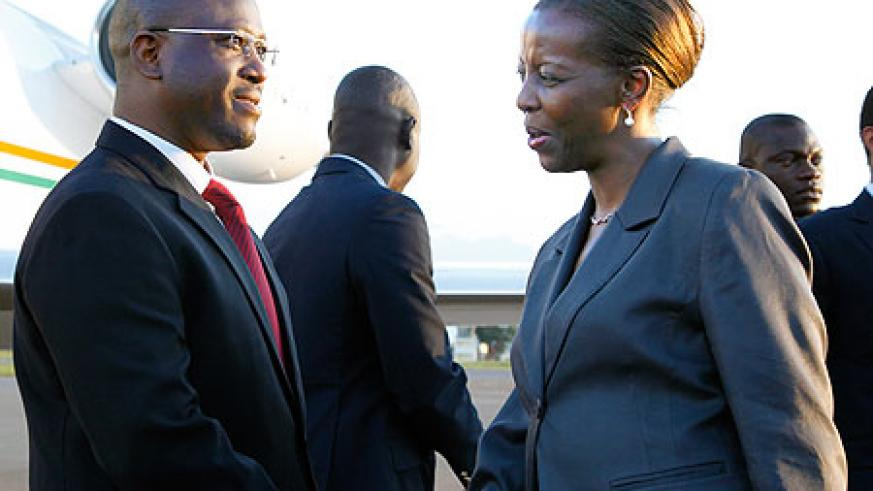 Foreign Affairs Minister, Louise Mushikiwabo, greets Guillaume Soro, the Prime Minister of Ivory Coast, on his arrival at Kigali International Airport. The New Times /Timothy Kisambira.