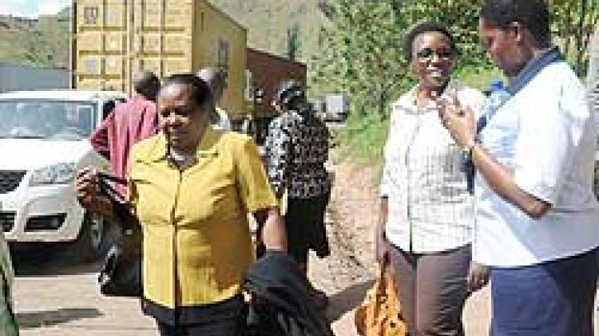 EALA MPs Odette Nyiramirimo (2nd right)  and Kate Kamba (L) talk to a clearing agent at the Rusumo border post on Monday. The New Times / John Mbanda.