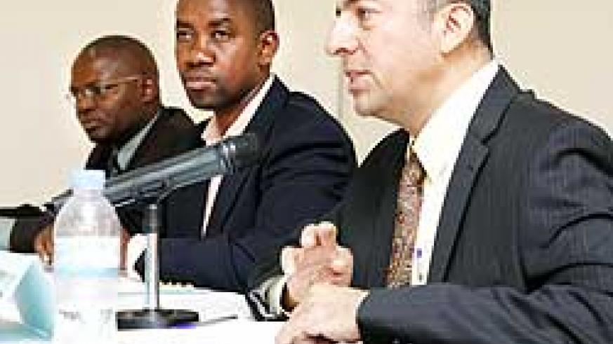 (R-L)Tito Farias the Country Director of IREX, Pascal Bizimana Rugemintwari Permanent Secretary in the Ministry of Justice and Apollinaire Mupiganyi of Transparency Rwanda yesterday. The New Times / T. Kisambira