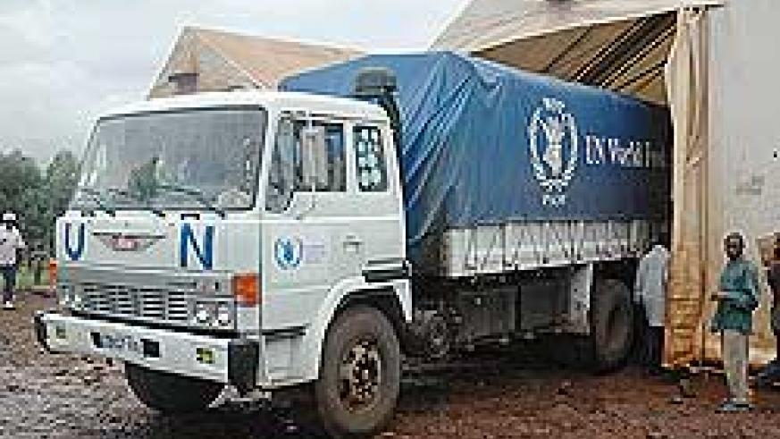 A WFP truck offloads food supplies at a refugee camp in the country. Germany has stepped in to rescue Congolese refugees in Rwanda. The New Times / File.