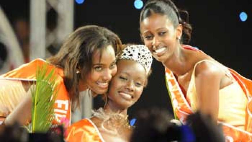 Miss Rwanda 2009 Grace Bahati (C), poses for a photo with the first and second runners-up, Carine Rusaro Utamuliza (L) and Winnie Ngamije The New Times/File photo