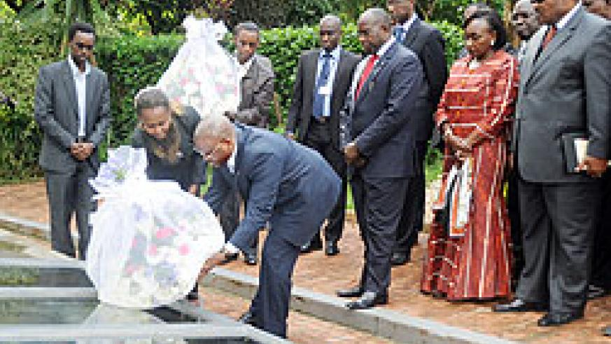 The Prime Minister of Côte d'Ivoire, Guillaume Soro, pays tribute to Genocide Victims at Kigali Memorial Centre yesterday.  The New Times / John Mbanda.