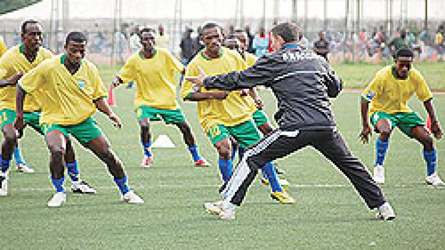 LEADING BY EXAMPLE: Amavubi Stars coach Sredejovic Milutin show his players how it is done during the team's last training session, on Wednesday, before departing to Eritrea. The New Times / Bonnie Mugabe