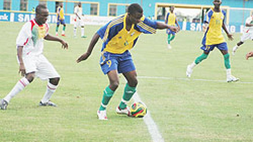 Baby (R) came off the bench to equalise for Amavubi yesterday. The New Times/File photo.