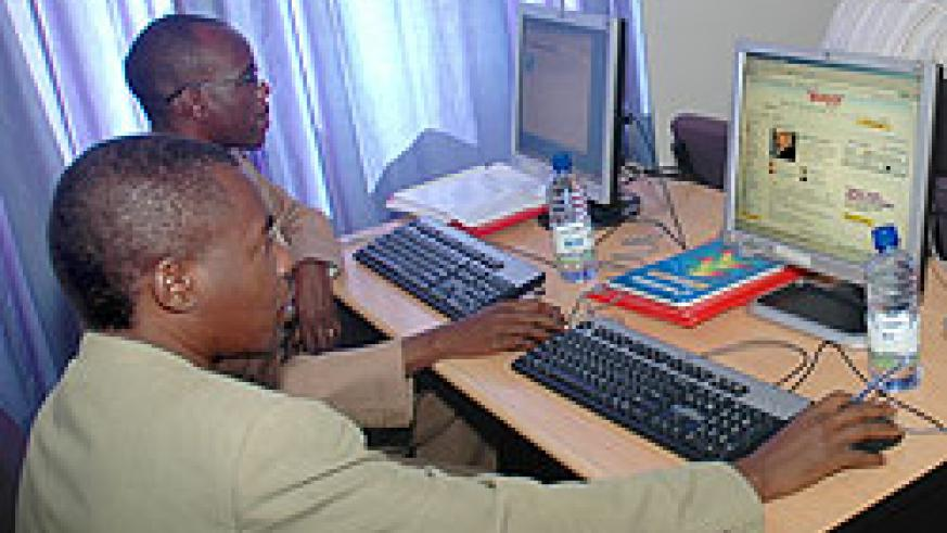 Clients in a Kigali internet cafe. The new Kigali Wireless Broadband, Wibro, is said to be more affordable and reliable. The New Times / F. Kanyesigye