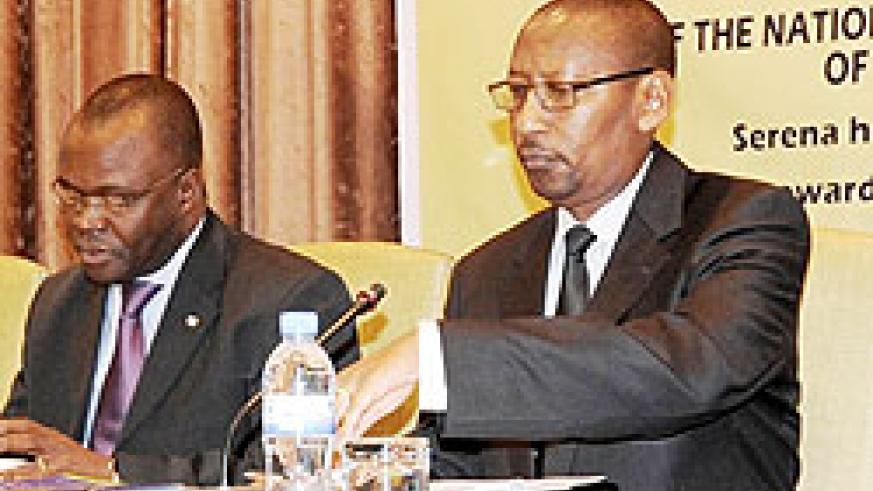 Both UNDP's Agbenonci (left) and minister Rwangombwa say the report ignores recent developments in the country. The New Times / File.