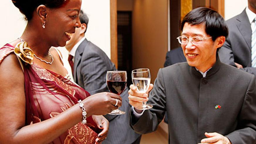 Foreign Affairs Minister Louise Mushikiwabo makes a toast with Chinese ambassador to Rwanda Shu Zhan at the 40th anniversary celebrations in Kigali. The New Times / Timothy Kisambira.