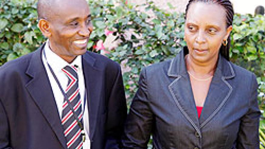 (R-L) Enata Dusenge, acting PS in the Ministry of Finance flanked by Augustus Seminega, the RPPA boss yesterday. The New Times / T. Kisambira