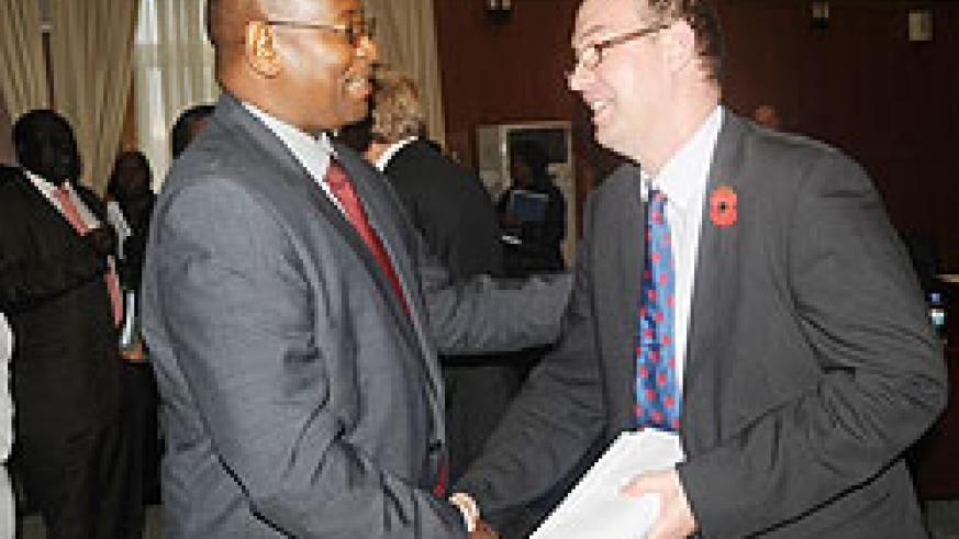 Local Government Minister Musoni and UK High Commissioner in Rwanda Benedict Llewellyn-Jones, during the JGA meeting yesterday. The New Times / John Mbanda.