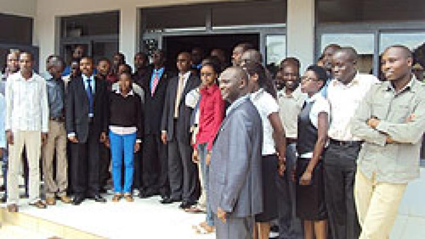 Officials from NISR pose for a group photo with statistics students during the  launch of the Statistics Week.The New Times / JP Bucyensenge.