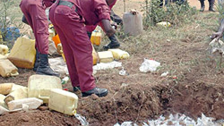 Members of the Local Defence Force distroying  illicit brew