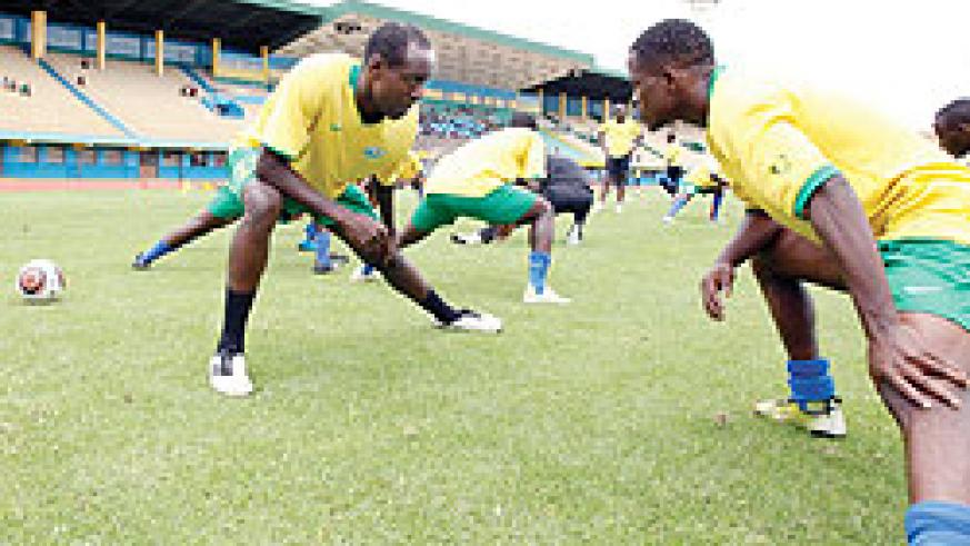 Amavubi players stretching during a training session. The New Times/T. Kisambira.