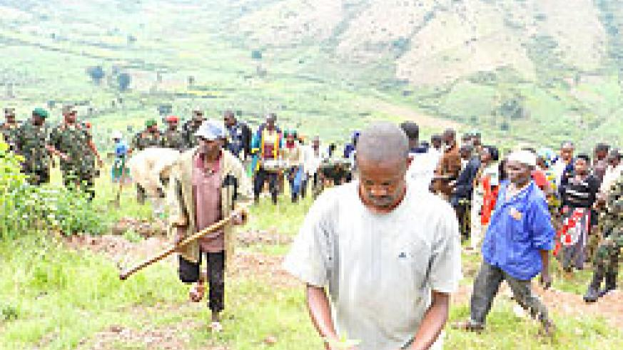 Residents join the tree planting drive on Rwimishinya mountains.The New Times / S. Rwembeho.