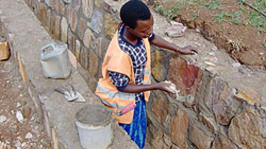 Women have not been left behind in jobs previously reserved for men like construction. Minister Aloisea Inyumba has challenged them to be confident. The New Times / File.
