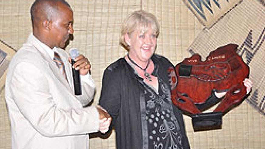 Karongi Mayor Bernard Kayumba hands a gift to the Mayor of Dieulefit District in France Christine Prietto as a sign of unity. The New Times / Sam Nkurunziza.