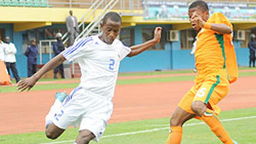 Rusheshangoga takes on an Ivory Coast player during the 2011 CAF U-17 Africa championship. The youngster has been drafted into the senior side. The New Times / File.