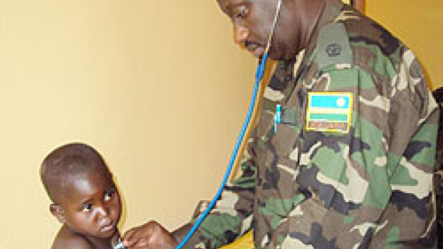 An RDF paediatrician attends to one of the children at Gihara Health Centre. The New Times / D. Sabiiti.