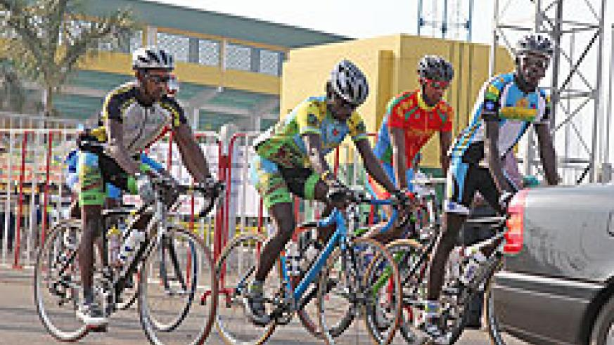Karisimbi rider Gasore Hategeka (C) is hoping to build on yesterday's impressive display. The youngster is second in the general classification. The New Times / File.