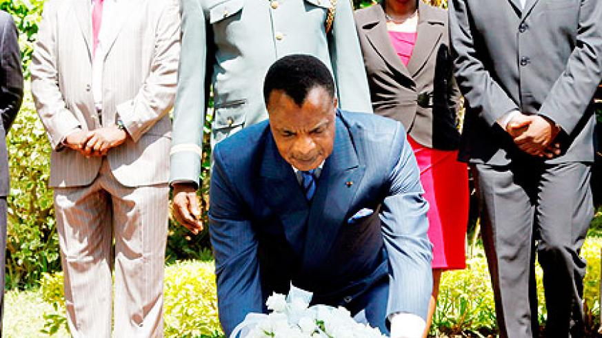 President Denis Sassou N'Guesso of the Republic of Congo lays a wreath at the Kigali memorial center, yesterday. The New Times / Timothy Kisambira.