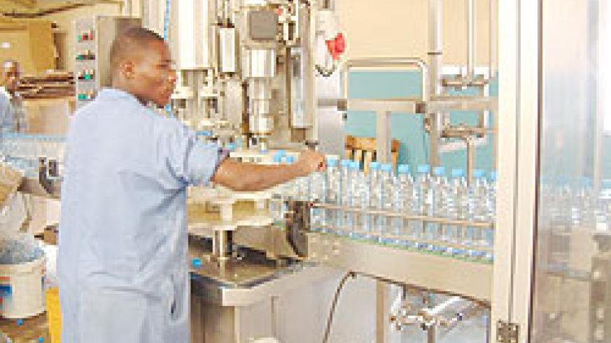 Workers in a Rwandan water bottling plant; Manufacturers have decried the high costs of production in the country.The New Times /  File.