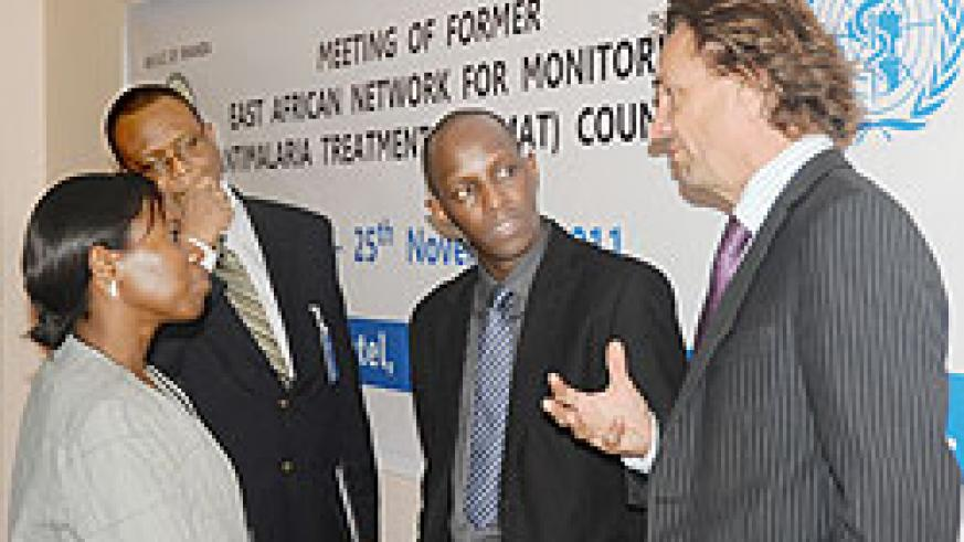 (L-R) Dr.Corine Karema in charge of Malaria control at RBC, Dovlo Delanyo of WHO,Leon Mutesa also from RBC and Regional malaria Advisor Africa-Dr. Alastair Robb at the meeting. The New Times / J. Mbanda.