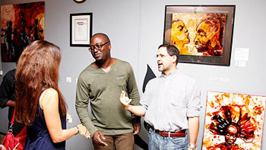 Kezio-Musoke David (C) chats with some of the guests at the event. The New Times / Timothy Kisambira.