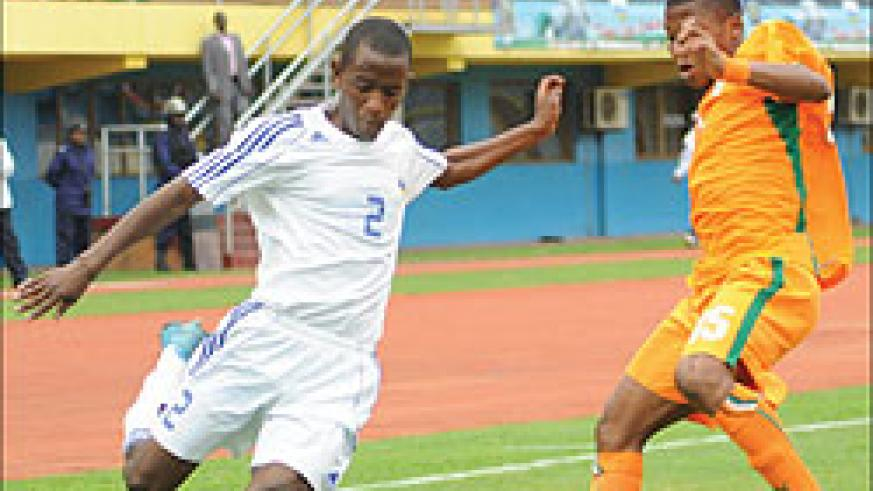 Rusheshangoga takes on an Ivory Coast player during the 2011 Africa U-17 Championship. The youngster has been called up to replace Gabriel Mugabo in Dar es Salaam. The New Times / File.