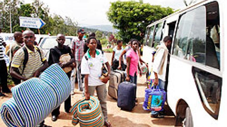 Students board a mini-bus as they head for Ingando, yesterday. Close to 40,000 will participate in the three-week exercise. The New Times /Timothy Kisambira