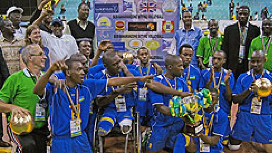 CHAMPIONS: The national sitting volleyball team pose for a photo shortly after qualifying for next year's Paralympic Games in London. The New Times / O. Arinaitwe.