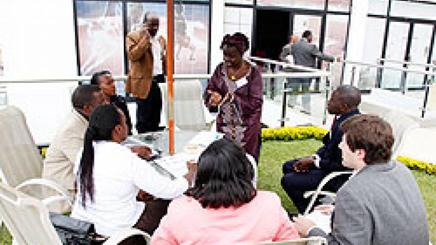 Participants in a group discussion during the meeting on NCDs. The New Times / T. Kisambira.