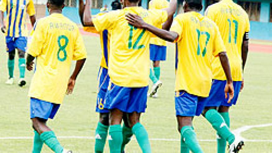 Amavubi players celebrate after scoring against Eritrea in the 2014 Fifa World Cup second leg qualifier. The New Times/T. Kisambira.