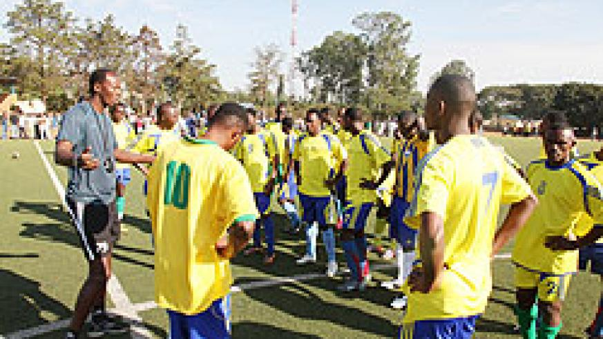 Amavubi players listening to the assistant coach Eric Nshimiyimana, during a training session.. The New Times / File.