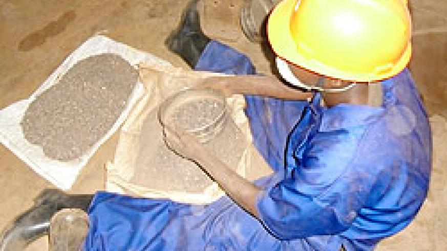 A miner at a Nemba site sorting cassiterite. The new firm will add value to the ore. The New Times /File.