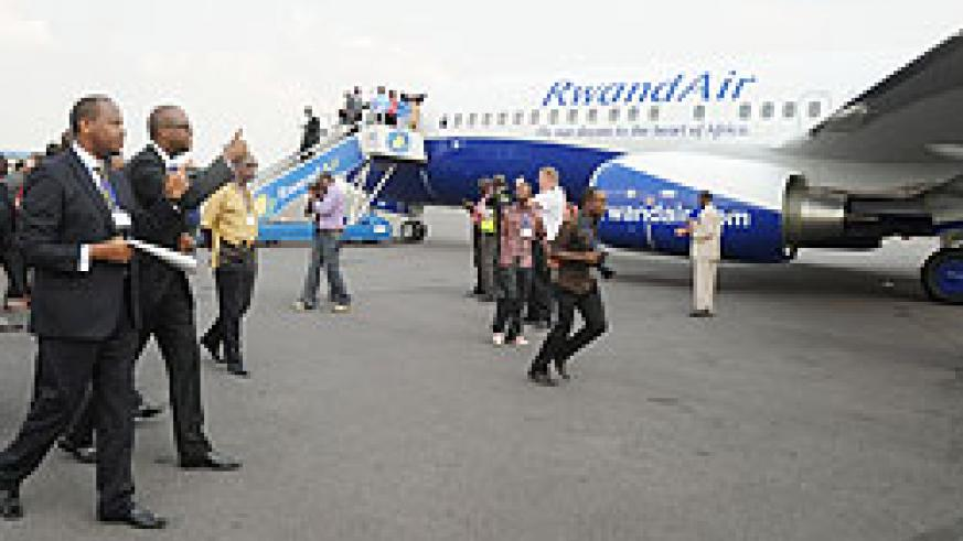 Minister of Infrastructure Albert Nsengiyumva and Rwandair's John Mirenge at the inauguration of the New Boeing Sky Interior. The company has launched direct flights to Nigeria. The New Times/ File.