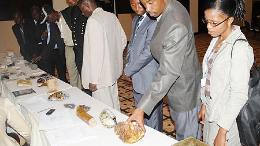 Guests and investors examine various mineral samples during the International Mines Day celebated in Kigali, Yesterday. The New Times /John Mbanda.