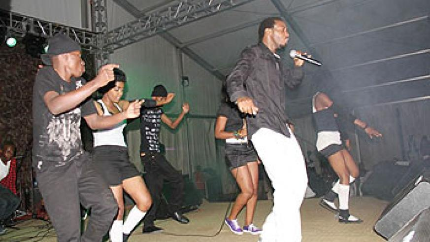 Kamichi and his dancers take on the stage during the launch of his debut album 'Umugabirwa'