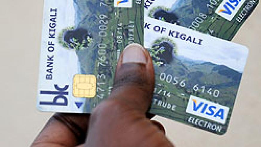 Bank of Kigali's Visa electron cards. Government aims to set in motion a cashless economy.  The New Times / J. Mbanda