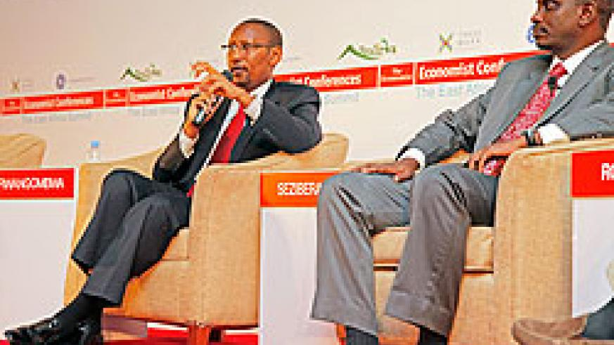 Finance Minister John Rwangombwa (L) speaks during the EA Summit yesterday. Looking on is EAC Secretary General, Richard Sezibera. The New Times / T.Kisambira.