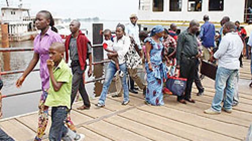 Congolese arrive in neighbouring Congo- Brazzaville. Others are in Gisenyi fearing post election unrest. Net photo.