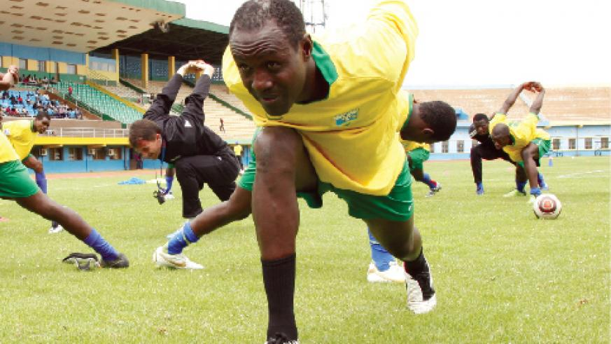 Rwanda's goal scoring machine Olivier Karekezi stretching during one of the team's training sessions.