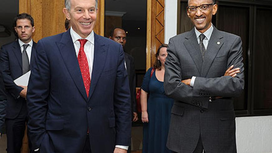 President Kagame and Tony Blair chat after their meeting at Village Urugwiro yesterday. The New Times / Village Urugwiro