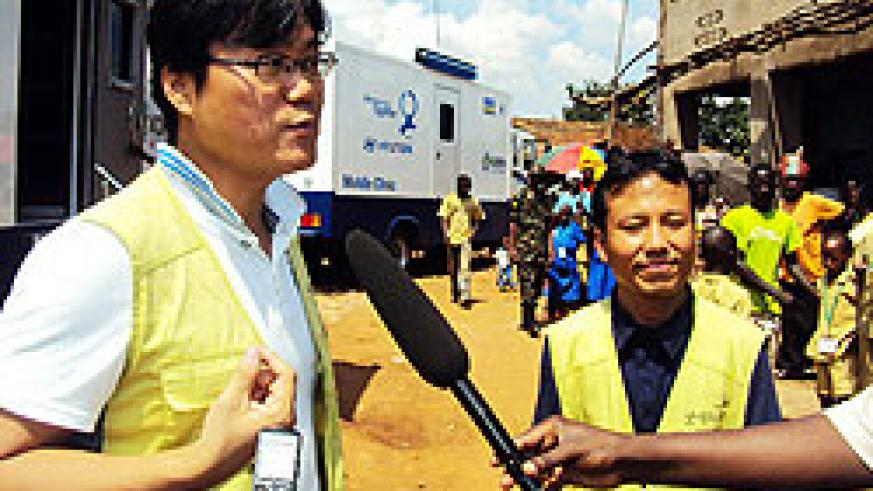 Managing-Director-of-Good-Neighbours-David-Sehyeon-Baek,(left)-speaks-to-reporters.-Photo-Sunday-Times-D.Sabiit