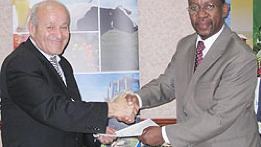 Algerian-CEVITAL-Group-representative-Issad-Rebrab-(L)-and-RDB-CEO-John-Gara-after-signing-the-MoU.-The-New-Times-Courtesy.