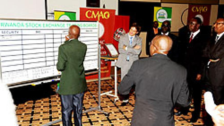 Goverment officials and other guests during the launch of Rwanda Stock Exchange. The New Times/ File.