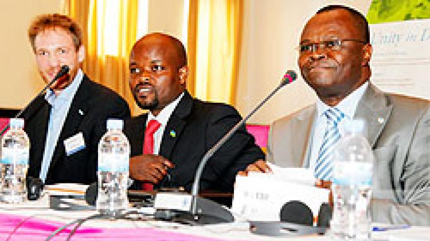 L-R: UNV's Ivan Dielens, Minister Jean Philbert Nsengimana and the UN Resident Coordinator Aurelien Agbenonci at the meeting yesterday. The New Times / T. Kisambira