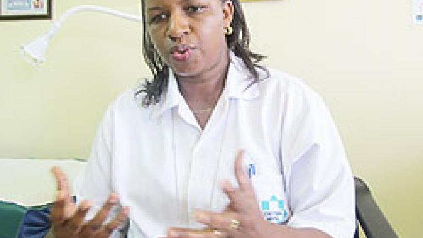 Fortunee Kamanyana, In-charge of antenatal care at King Faisal Hospital, says involving men in pregnancy and birthing is necessary. The New Times / D. Umutesi.