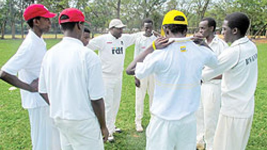 Impala Titans players converge for a brief team talk before this year's Sulfo cricket league final against Right Guards at Kicukiro oval. The New Times/O. Arinaitwe.