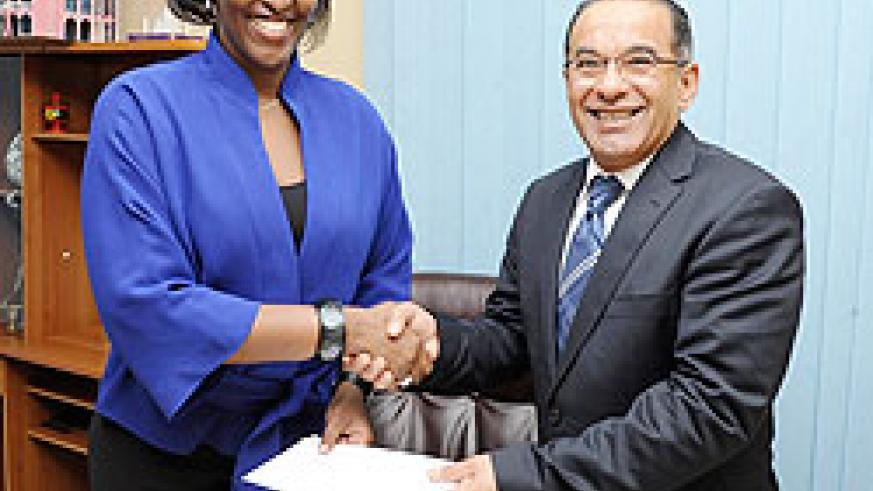 First Lady, Mrs Jeannette Kagame receives the cheque from  MTN CEO Khaled Mikkawi . The New Times / coutesy