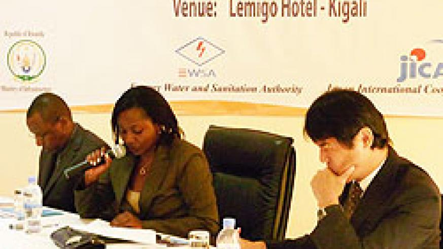 State-Minister-Emma-Francoise-Isumbingabo-addresses-participants,-JICA`s-Kobayashi-Hiroyuki-(R)-and-Aimable-Habinshuti-during-the-meeting.-The-New-Times-Grace-Mugoya